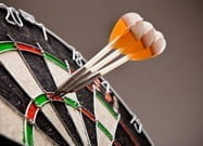 Three darts in the treble 20 slot of a dart board