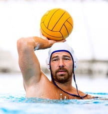Water polo player with the ball in his hand