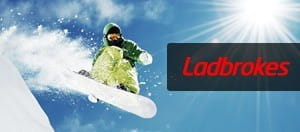 Snowboarder catching air with Ladbrokes logo overlayed