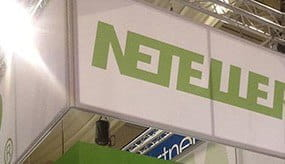 A Neteller logo displayed on the inside of a office building