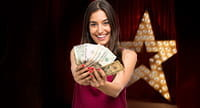 A reality show contestant holding money