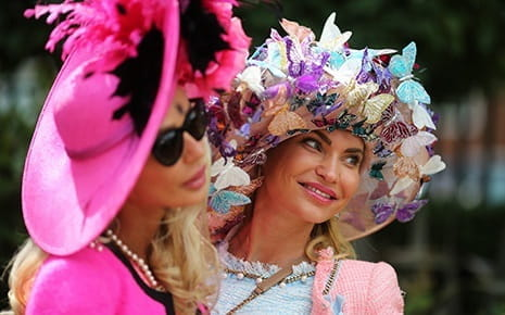 it is common for women to wear dresses, hats and heels to prestigious horse racing events