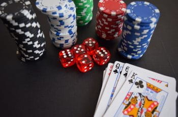 Cards, poker chips and dice