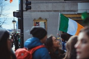 A man holding an Irish flag