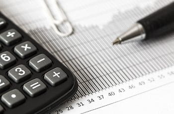 A calculator, pen and graph
