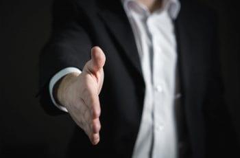 A man offering a handshake.