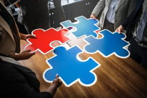 Jigsaw pieces in a meeting
