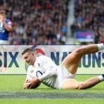 Jonny May's incredible hat-trick helped England to an easy 44-8 victory over the French. Unbeaten England now tops the Six Nations table.