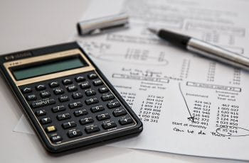 Finance documents and a calculator