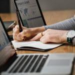 Laptops and a finance sheet