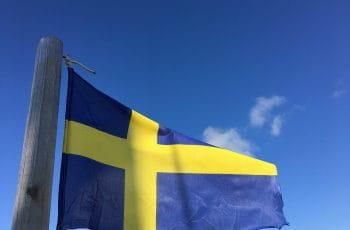 Swedish flag against a blue sky