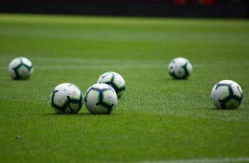 footballs on pitch