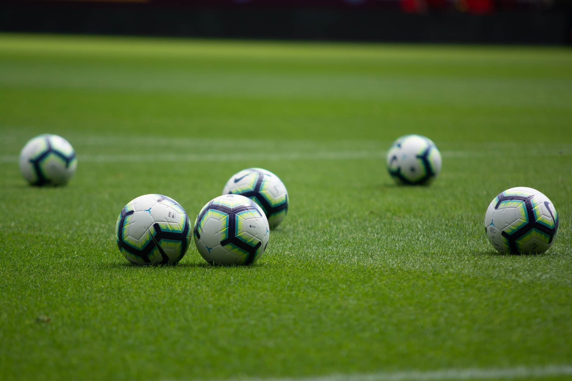footballs on pitch